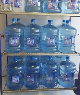 A rack of water containers